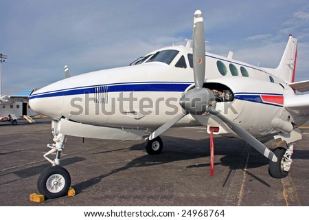 A private plane in the hangar - stock photo