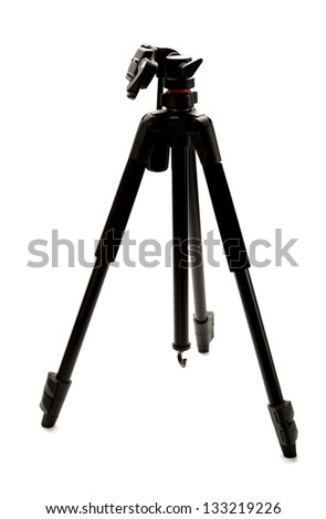 A professional photo tripod isolated on white background. - stock photo