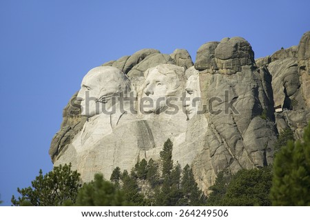 A profile of Presidents George Washington, Thomas Jefferson, Teddy Roosevelt and Abraham Lincoln at Mount Rushmore National Memorial, South Dakota - stock photo
