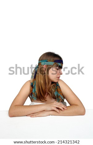 A profile shot of a lovely teenage girl wearing a colorful headband.  Isolated on a white background with generous copyspace.  - stock photo