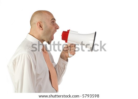 A profile view of a businessman wearing a white shirt and tie, yelling into an electronic bullhorn or megaphone. Isolated on white background. - stock photo