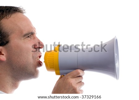 A profile view of a man yelling into a blowhorn, isolated against a white background - stock photo