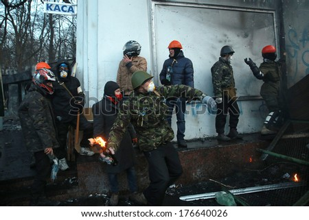 A protester throws a Molotov cocktail at the police. Kyiv, Ukraine, January 20, 2014 - stock photo