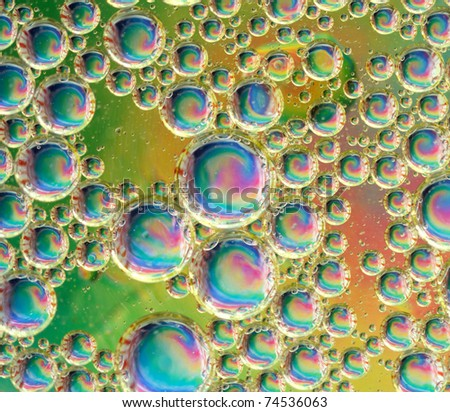 A psychedelic background of an oil and water mixture - stock photo
