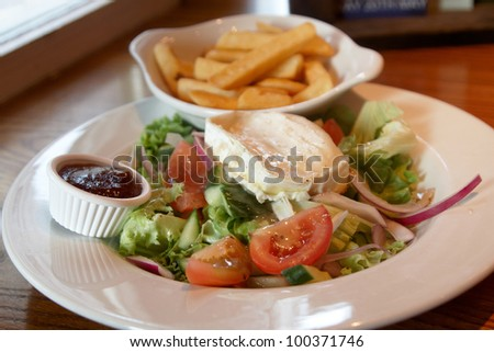 A Pub meal of chips and salad - stock photo