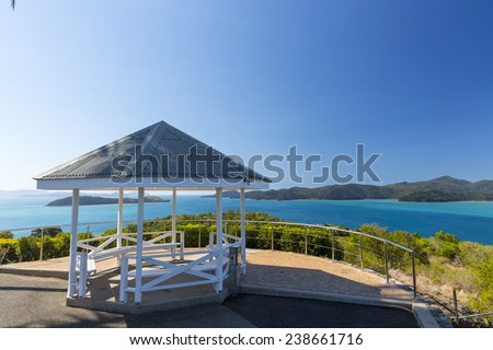 A public lookout over the nearby islands and reef from the top of Hamilton Island - stock photo