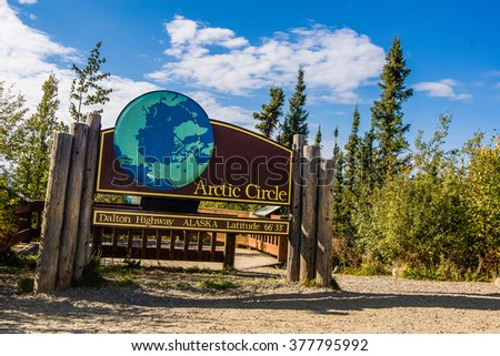 """A public sign marks the Arctic Circle on the only road to cross it in the United States, the Dalton Highway or """"Haul Road"""" in northern Alaska - stock photo"""