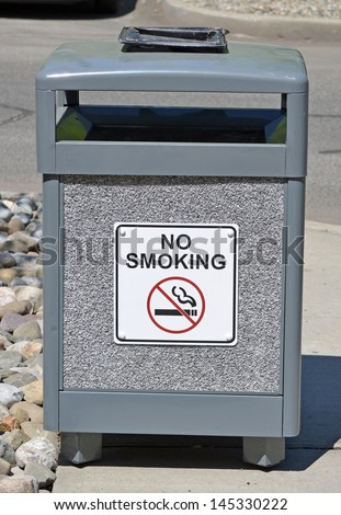 A public trash can with a No Smoking sign on it - stock photo