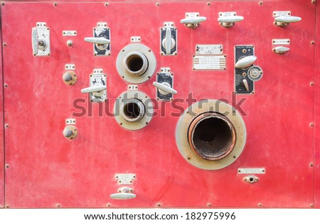 A pumper fire truck's complex control panel - stock photo