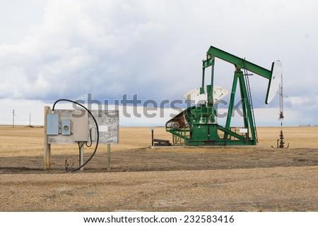 A pumpjack in Alberta, Canada - stock photo