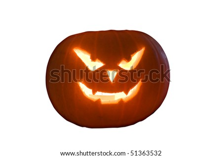 A pumpkin carved with a spooky image for halloween - stock photo