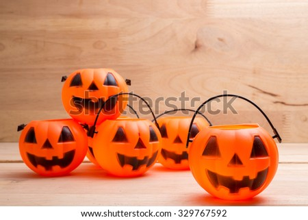 a pumpkin jack head on wood background for halloween holiday use (selective focus technique applied)