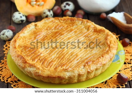 A pumpkin pie on table - stock photo