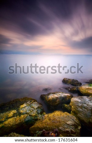A purple dawn with silky water effect - stock photo