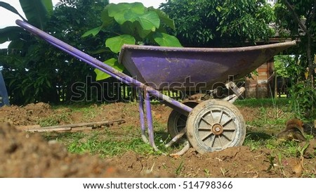 a purple garden dump cart