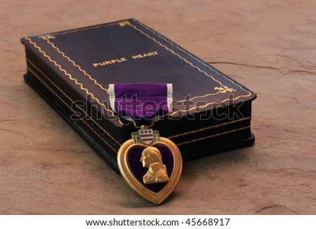 A Purple Heart Military Decoration Draped in Front of its Box - stock photo