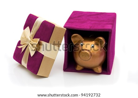 A purple velvet present opened with piggy bank and gold bow isolated on white, Happy Holidays - stock photo