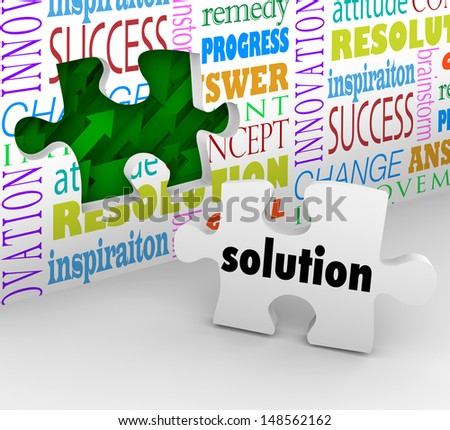 A puzzle piece with the word Solution as the answer to a problem or solved challenge and a wall filled with words such as inspiration, resolution and innovation - stock photo
