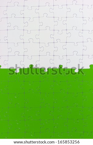 A puzzle, which in each half of a different color. - stock photo