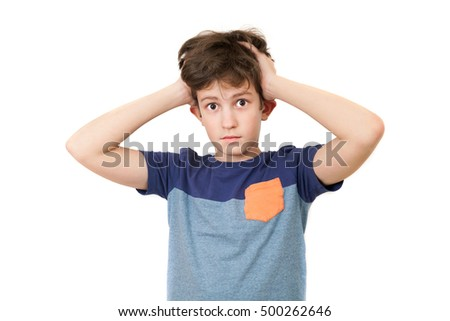 A puzzled boy holding his head