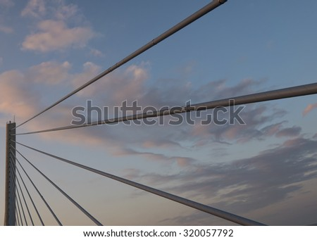 A pylon and cables on the Indian River Bridge in Delaware at sunset.
