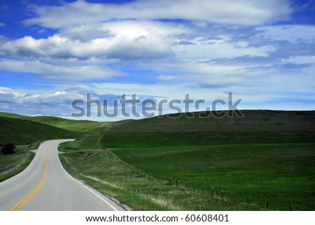 A quiet, lonely highway in Montana on a summer's day - stock photo