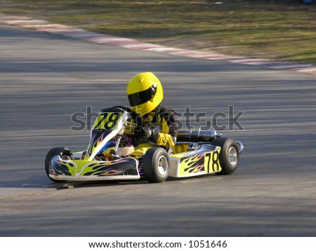 A racing yellow and black cadet go kart. - stock photo