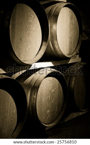 A rack of wine wooden barrels in an aging cellar, here the wine sleeps for years