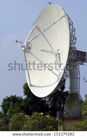 A radio telescope is a form of directional radio antenna used in radar airport - stock photo