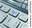 A radio transmitter on the keyboard symbol. - stock photo