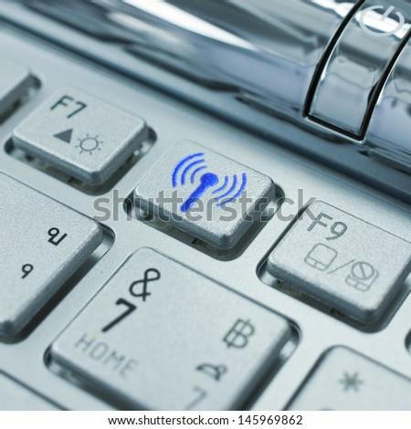 A radio transmitter on the keyboard symbol. - stock photo