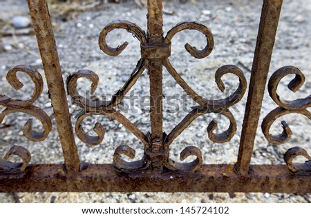 A railing eaten away with rust - stock photo