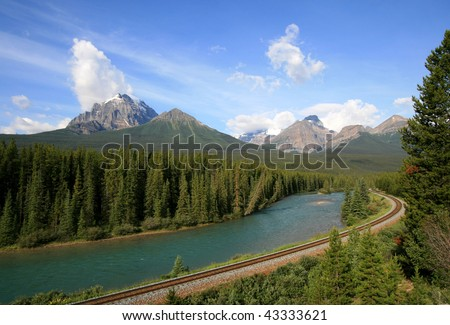 A railroad along the Bow River near Lake Louise in Banff National Park, Alberta, Canada. - stock photo