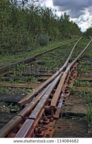A railway tracks junction in vertical - stock photo