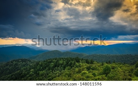 A rain storm in the distance is moving in at sunset along the Blue Ridge Parkway in Western North Carolina. - stock photo