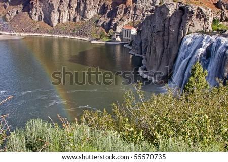 A rainbow appears over Twin Falls, Idaho. - stock photo