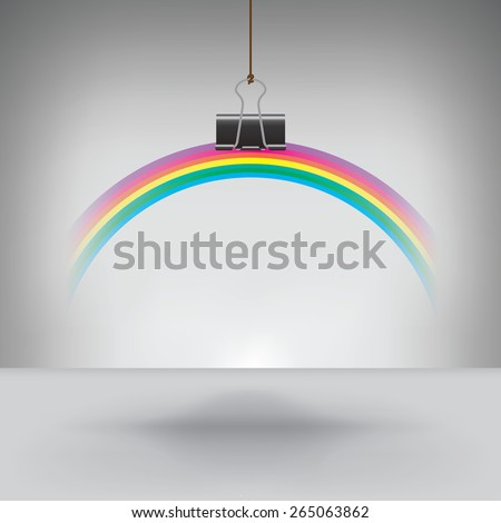 A Rainbow Hung by a Binder Clip - stock photo