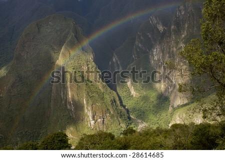 A rainbow over Machu Picchu Valley in Peru, South America - stock photo