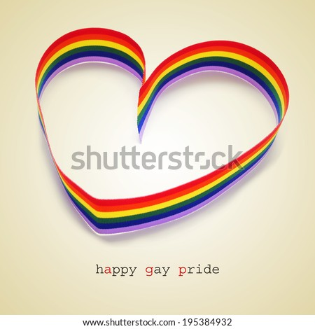 a rainbow ribbon forming a heart and the sentence happy gay pride - stock photo