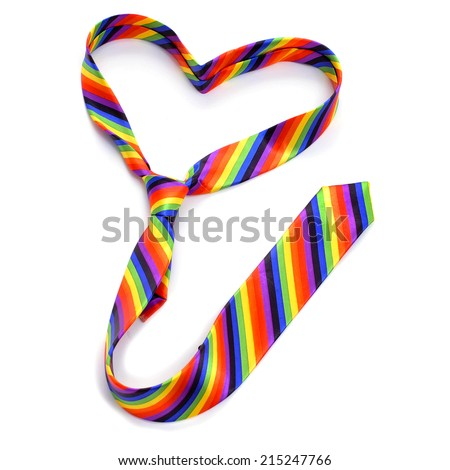 a rainbow tie forming a heart, depicting the concept of gay love, on a white background - stock photo