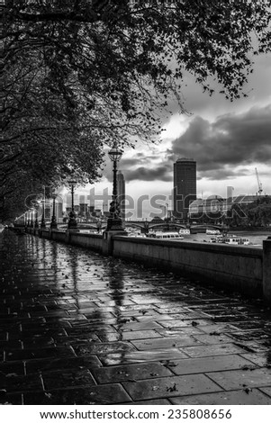 A rainy day on the South Bank of River Thames with Palace of Westminster in Background, London, England, UK  - stock photo