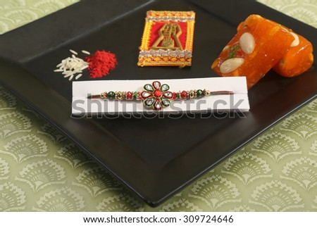 A rakhi is traditionally tied by a sister to her brother on the Raksha-Bandhan festival day in India.