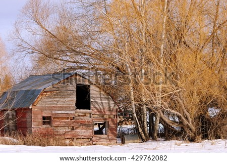 A ranch outbuilding in Montana's snow. - stock photo