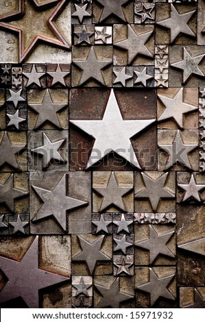 A random arrangement of letterpress stars with narrow depth of field. Part of a series of letterpress backgrounds - stock photo