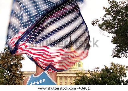 A raver waves a flag during a protest in front of the United States Capitol Building in Washington, D.C. - stock photo