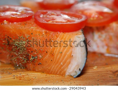 A raw Salmon fillets with tomatoes, ready to grill. Close up - stock photo