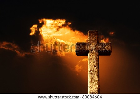 a ray of sun shines through the darkness - stock photo