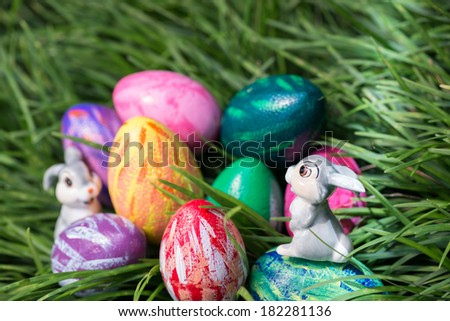 A ray of sunlight shining onto the Easter bunny sitting on top of an egg close-up