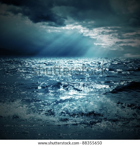a ray of sunshine on the sea - stock photo