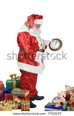 A real Santa Claus portrait checking his clock - stock photo